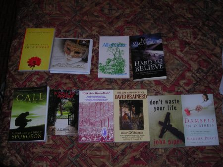 Yes... That's what happens when I hit a bookstore. (Top row Steve's, bottom row mine)